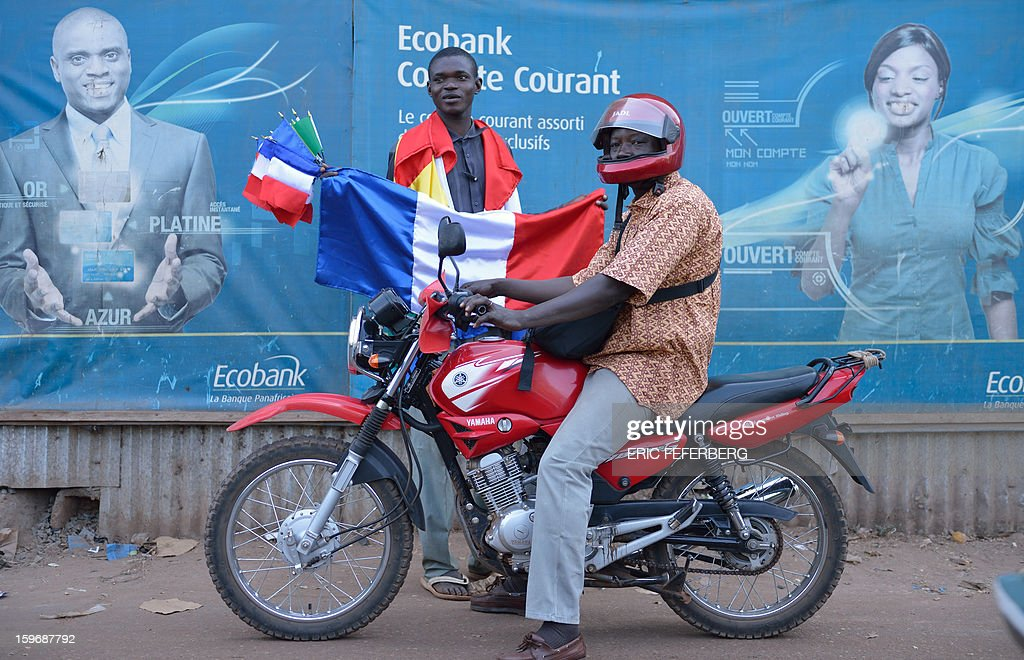 A Malian man sells French flags on January 18, 2013 in a street of Bamako