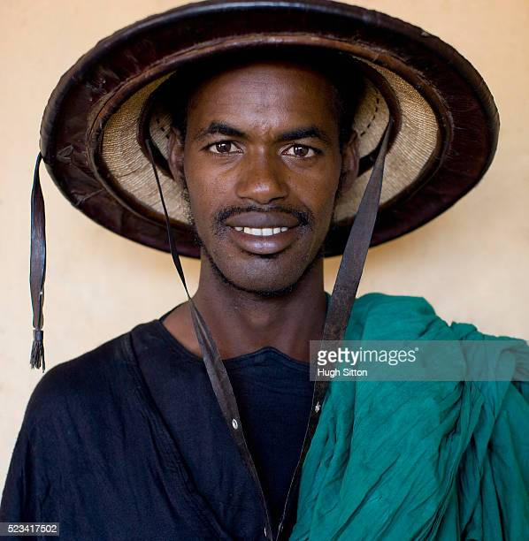 malian man wearing traditional clothing - hugh sitton stock pictures, royalty-free photos & images