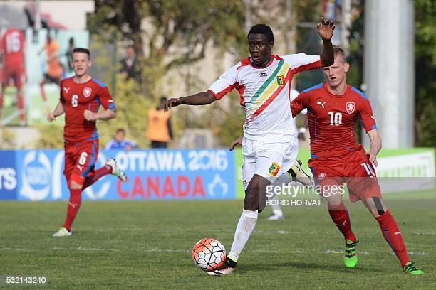 Malian midfielder Diadie Samassekou vies with Czech midfelder Petr Kodes during the Under 21 international football match between Czech Republic and...