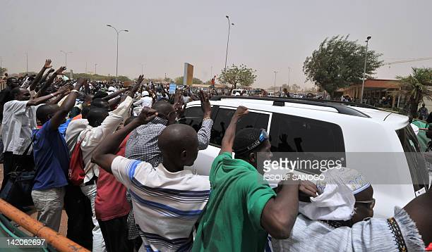 Malian military junta supporters wave on March 29 2012 as coup leader Amadou Sanogo leaves Bamako airport by car A bid by west African leaders to...