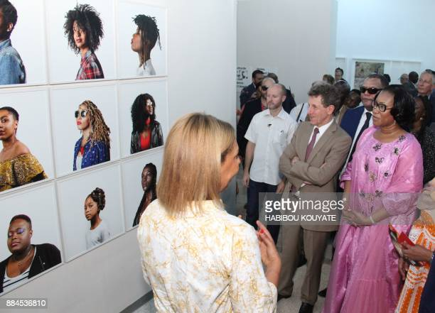 Malian Minister of Culture NDiaye Ramatoulaye Diallo looks at works by French photographer Helene Jayat during the opening of the 11th Rencontres de...