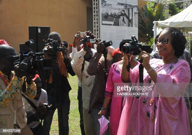 Malian Minister of Culture NDiaye Ramatoulaye Diallo takes photos during the opening of the 11th Rencontres de Bamako' the African Biennale of...