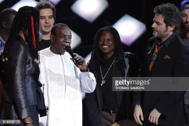 Malian musician and singer Toumani Diabate flanked by Malian singer Fatoumata Diawara and French songwriter singer musician and composer Matthieu...