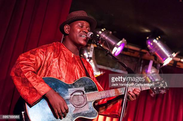 Malian musician Mamadou Kelly plays acoustic guitar on the Acoustic Africa Tour at BB King Blues Club Grill in Times Square New York New York April 6...