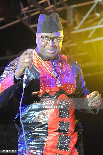 Malian musician Nampe Sadio performs during the Bye bye Au revoir Ebola concert on December 30 2015 in Conakry International artists Youssou Ndour...