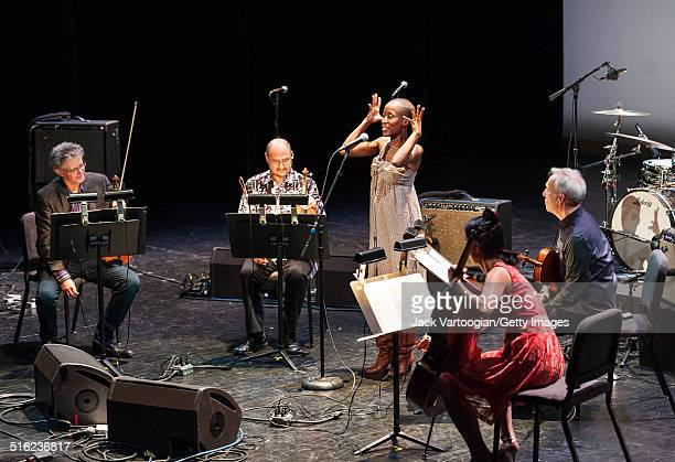 Malian musician Rokia Traore performs onstage with the Kronos Quartet at a concert during the 2014 Next Wave Festival at the BAM Howard Gilman Opera...