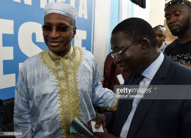 Malian opposition leader and presidential candidate Soumaila Cisse greets candidate of ADPMaliba party Aliou Boubacar Diallo during a press...