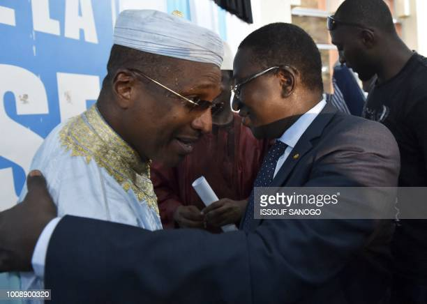 Malian opposition leader and presidential candidate Soumaila Cisse hugs candidate of ADPMaliba party Aliou Boubacar Diallo during a press conference...