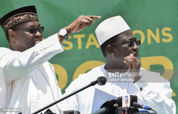 Malian Opposition leader Soumaïla Cisse gestures alongside his campaign director Tiébilé Dramé as he addresses supporters at his party headquarters...