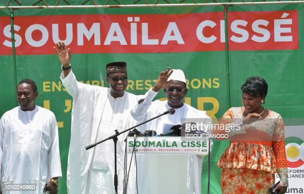 Malian Opposition leader Soumaïla Cisse gestures as he addresses supporters alongside his campaign director Tiébilé Dramé at his party headquarters...