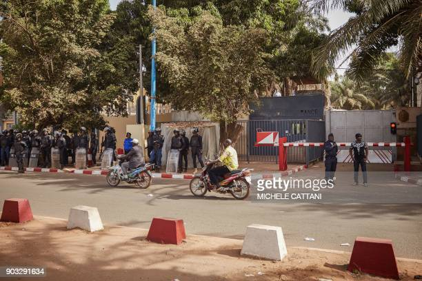 Malian police forces deploy in front of the French Embassy to block a group of demonstrators marching in Bamako to protest against the ongoing...