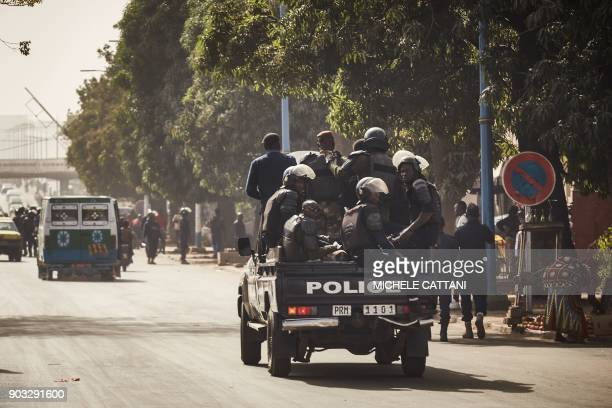 Malian police forces deploy to block a group of demonstrators marching towards the French Embassy in Bamako to protest against the continued presence...