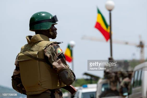 Malian police forces secure the area during the National Day military parade on September 22 2018 in Bamako Mali