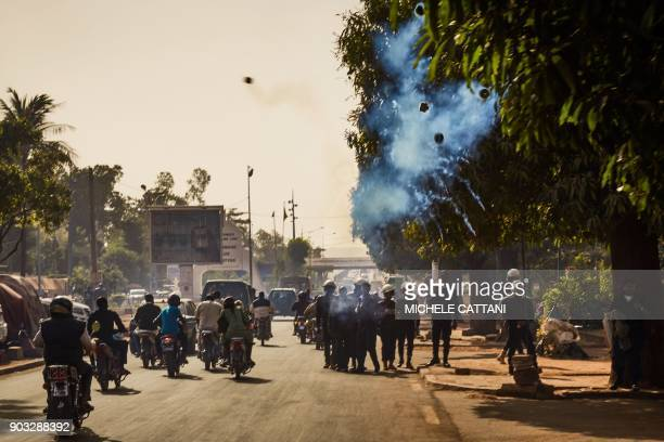 Malian police forces use tear gas to disperse a group of demonstrators marching towards the French Embassy in Bamako to protest against the continued...