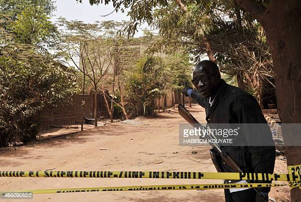 A malian police officer shows on March 13 2015 in Bamako the building where special forces troops in Mali killed a suspect in last week's deadly...