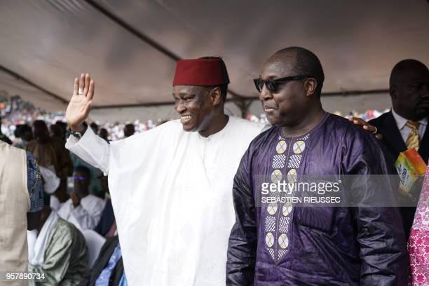Malian politician and former Foreign Affairs Minister Tiébilé Dramé and Burkina Faso politician Zephirin Diabre greet the crowd at a rally for Union...