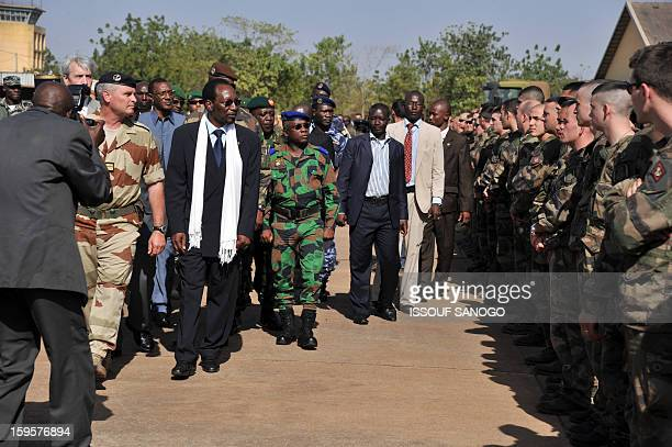 Malian president Dioncounda Traore and Ivory Coast chief of staff general Soumaila Bakayoko visit French troops on January 16 2013 at the military...