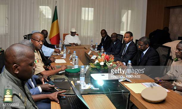Malian President Ibrahim Boubacar Keita attends a security meeting with the prime minister defence minister and the commanders of the armed forceson...
