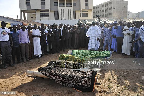 Malian Prime Minister Modibo Keita and Malian President Ibrahim Boubacar Keita attend the funerals of five of the victims of last week's attack in...