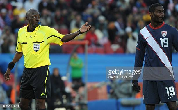 Malian referee Koman Coulibaly gestures near US midfielder Maurice Edu during their Group C first round 2010 World Cup football match on June 18 2010...