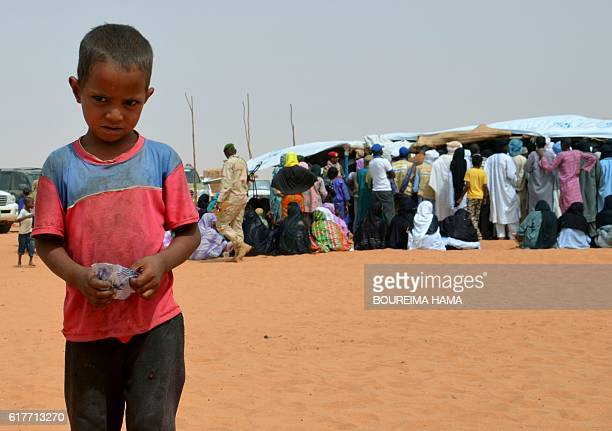 Malian refugee children are seen on October 20 2016 at the in Tazalit United Nations refugee camp in the Tahoua region some 300 kilometres northeast...