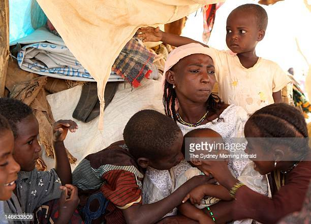 Malian refugee Saouda Baye mourns the death of her twoyearold son Moussa while another is being treated for malnutrition at a camp in Mangaize in...