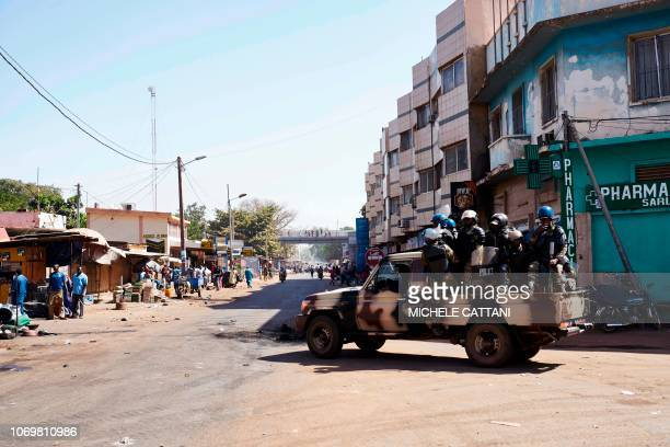 Malian riot police members arrive in a vehicle as they deploy during a protest called by opposition parties in Bamako on December 8 2018