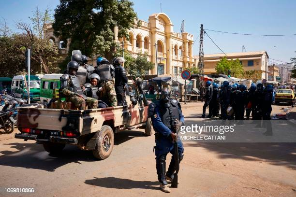 Malian riot police members take their positions during a protest called by opposition parties in Bamako on December 8 2018