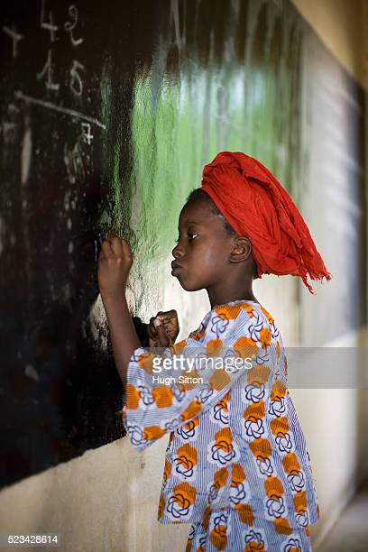 malian school girl writing in blackboard - hugh sitton stock pictures, royalty-free photos & images