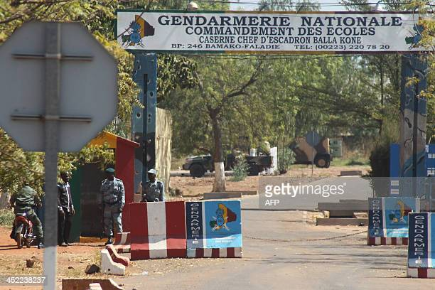 Malian security forces stand guard outside the gendarmerie where Malian excoup leader Amadou Sanogo was brought to after being detained in Bamako on...