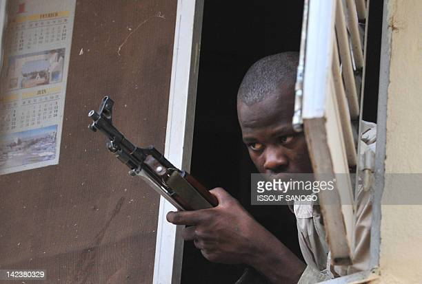 Malian soldier looks as junta leader captain Amadou Sanogo speaks on April 3 2012 at the Kati military camp near Bamako Mali's underfire junta on...
