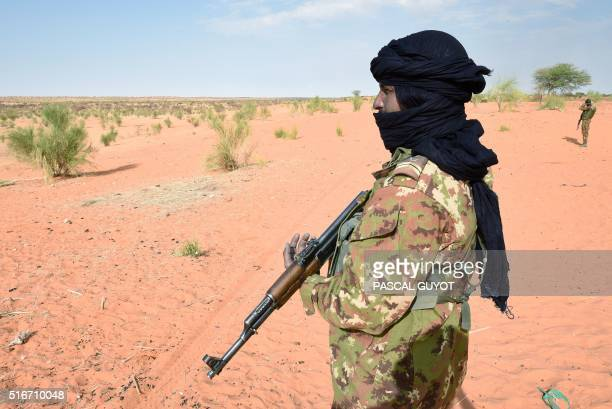 A Malian soldier patrols with French soldiers involved in the regional antiinsurgent Operation Barkhane on March 10 2016 in Timbamogoye France's...
