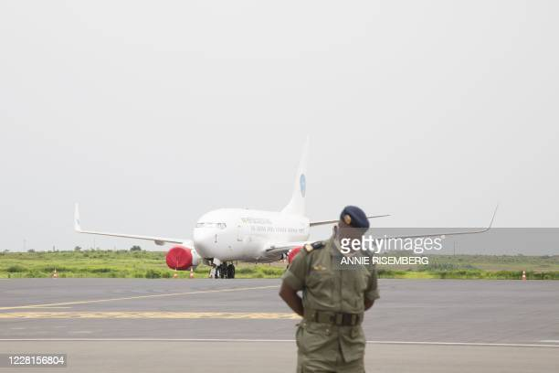 Malian soldier waits in front of the Malian Presidential aircraft on the runway of Bamako airport before a meeting between Malian military leaders...