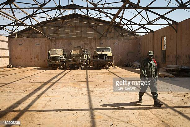 Malian soldier walks in an army camp on February 24, 2013 in the centre of Gao. Tuareg militias battled Arab rebels in northern Mali Saturday, while...