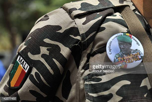 A Malian soldier where a badget showing of Mali's junta leader Captain Amadou Sanogo at the Kati military camp on April 1 2012 Mali's coup leader...