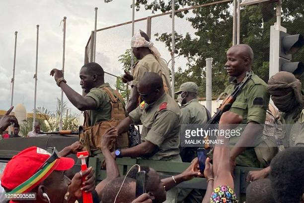 TOPSHOT Malian soldiers are celebrated as they arrive at the Independence square in Bamako on August 18 2020 Mali's Prime Minister Boubou Cisse...
