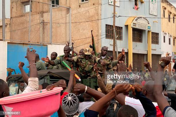 Malian soldiers are celebrated as they arrive at the Independence square in Bamako on August 18 2020 Mali's Prime Minister Boubou Cisse called on...