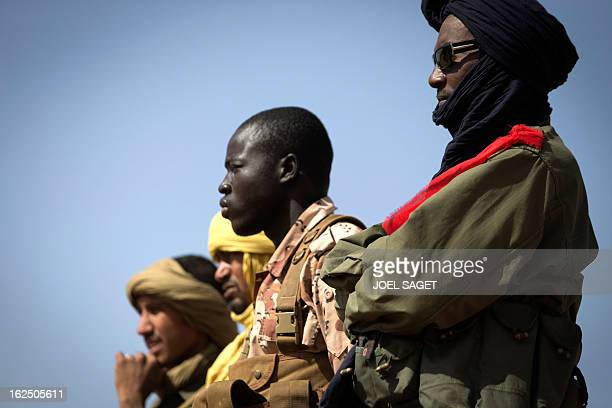 Malian soldiers are pictured in the centre of Gao on February 24, 2013. Tuareg militias battled Arab rebels in northern Mali Saturday, while French...