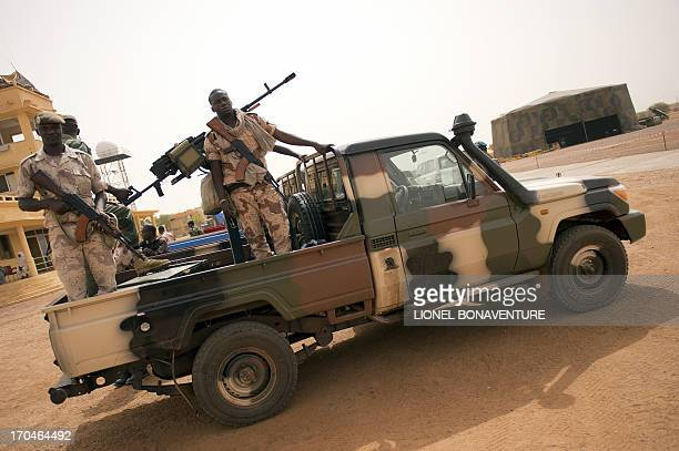 Malian soldiers are seen at the airport of Gao on June 13 2013 Gao fell in March last year to Tuareg rebels who declared the independence of the...