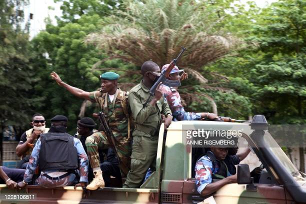 Malian soldiers drive through the streets of Bamako Mali on August 19 the day after rebel troops seized Malian President Ibrahim Boubacar Keita and...