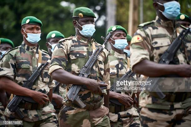 Malian soldiers march while paying tribute to former Mali President General Moussa Traore at his funeral in Bamako on September 18, 2020. - Mali held...