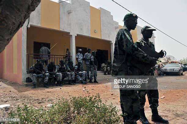 Malian soldiers mill around inside the milirary camp of Malian junta leader Amadou Sanogo in Kati near Bamako on March 30 2012 Mali's embattled coup...