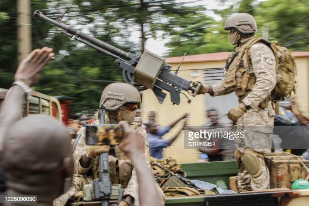 TOPSHOT Malian soldiers parade as they arrive by military vehicle at Independence Square in Bamako on August 18 after rebel troops seized Malian...