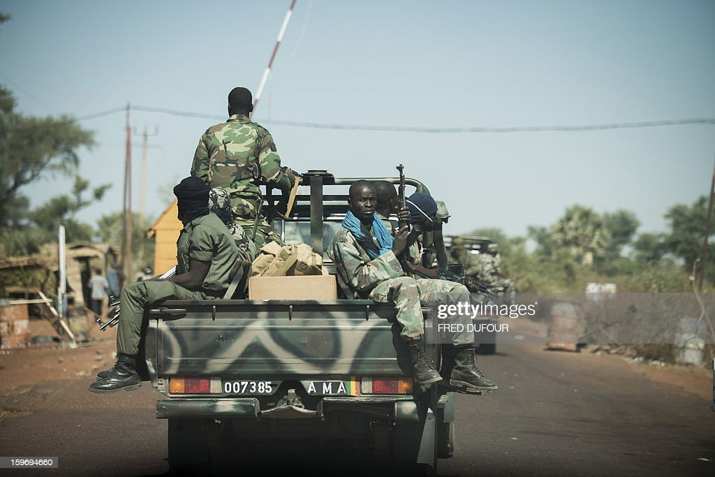 Malian soldiers sit in pick up on their way to Niono, 340km north from Bamako, on January 18, 2013 in Markala. France confirmed today that Malian troops had taken control of the key central town of Konna from armed Islamists who seized the country's vast desert north in April last year.