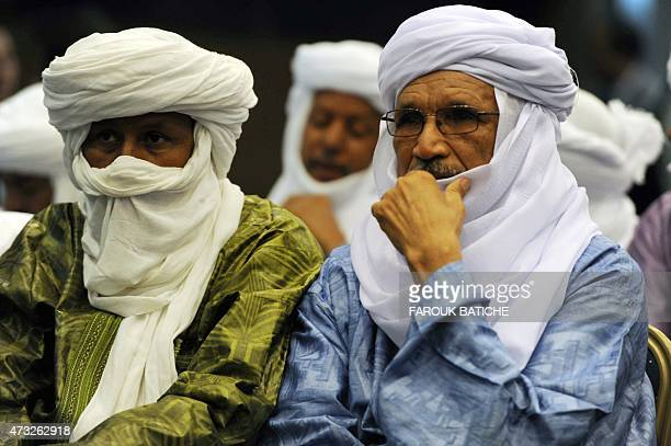 Malian Tuaregs attend a signing ceremony for a peace agreement between the Malian government and armed groups in the north of Mali on May 14 2015 in...