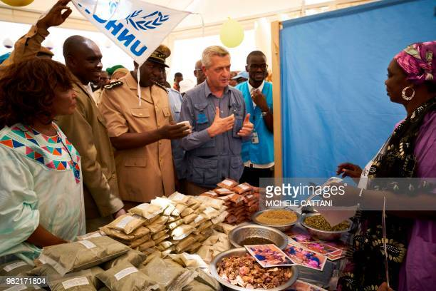 A Malian woman show United Nations High Commissioner for refugees Filippo Grandi UNHCR's representative in Mali Angele Djohossou and his delegation...
