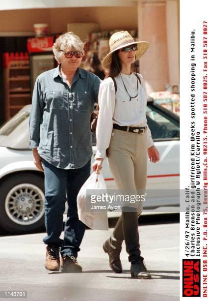 Malibu, Calif Exclusive Photographs. Charles Bronson and his girlfriend Kim Weeks do a spot of shopping in Malibu.