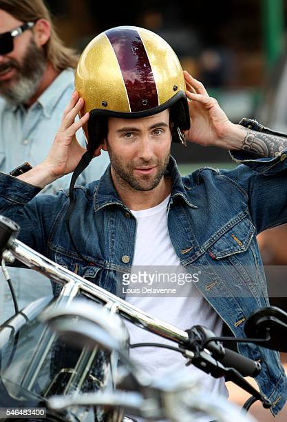 Malibu California July 4 2010 American singersongwriter guitarist frontman for the pop rock band Maroon 5 Adam Levine ride his Harley Davidson...