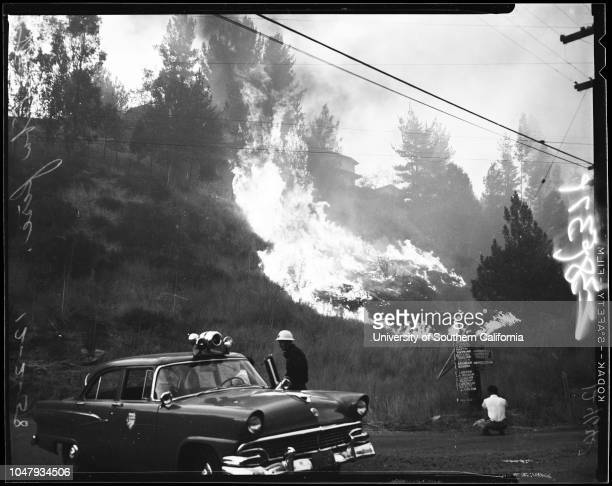 Malibu fire, 2 December 1958. Fire in the Virgenes Canyon area;Bob Hope Ranch;Purple Sage Ranch;Malibu Lake area;Floyd Baume;Suzette Baume ;Mrs Jesse...