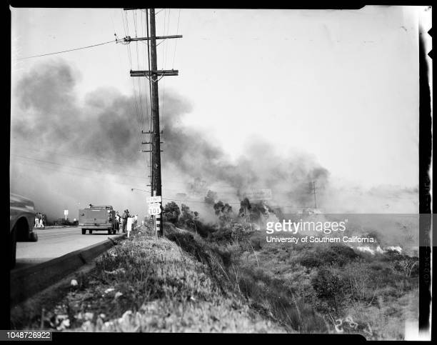 General view of fire and fire fighters 3 December 1958 Corral CanyonMalibu ColonyOcean side of hiway 101Lawrence Pittman 13 yearsGreg Pittman 9...